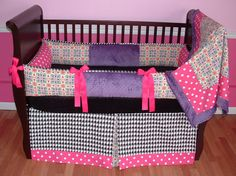 Linley Baby Bedding  Included in this modern 3 piece bedding set is the bumper, crib blanket, and tailored box pleat crib skirt.  There is lots of detail in this custom set including ultra soft violet minky, hot pink and white polka dots, hot pink grosgrain bows, black and white houndstooth, and designer floral medallion fabric.