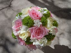 Soft pink roses, white hydrangea, green vibernum, ivory roses and stephanotis with crystal centers
