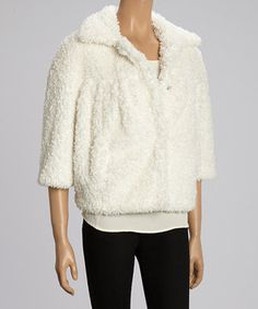 Bundle up and stay stylish in this fuzzy jacket with a plush collar to protect necks from howling winds.