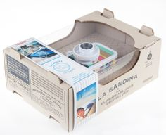 """La Sardina Beach Edition cameras """"Capri"""" and """"St.Tropez"""" were launched in Summer chic folding wooden beach chairs and the vintage summer look at the Côte d'Azur were the inspiration to develop this entire plastic/canvas camera collection. Print Packaging, Box Packaging, Packaging Design, Retro Design, Layout Design, Wooden Beach Chairs, Montserrat, Striped Canvas, Graphic Design Inspiration"""