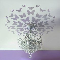 create a modern ceiling medallion with a wall decal or stencil and paint! I wouldn't do butterflies for the living room, but this is definitely an idea I would love to put into motion!