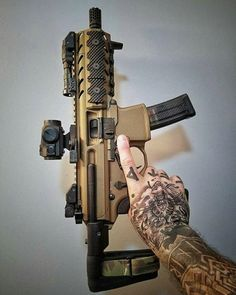 """tacticalsquad: """" pewfessional Pocket rocket Sig Mpx barrel cut to and re-threaded to by with synergy comp in burnt bronze cerakote. Airsoft Guns, Weapons Guns, Guns And Ammo, Molon Labe, Sig Mpx, Sig Sauer, Fire Powers, Military Guns, Cool Guns"""