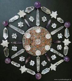A beautiful crystal and gemstone layout with stars, points and wands.