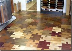 "A Jigsaw Puzzle floor by from Prowood Flooring.  It's not just clever, but made of well chosen, complimentary colors.  Fun & lovely.  See more in our blog post ""10 of the Most Awesome Floors Ever Created""."