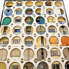 Beirut building with circular openings in façade...looks like a connect 4 game