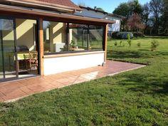 Réalisation d'une terrasse encadrant une maison à Longchamp. Entreprise EMTS