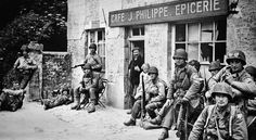 """GI's of 22nd Infantry Regiment(?), 4th Infantry Division """"Ivy Division"""", resting for few moments outside a cafe in Baudienville, village lies just under 2,5 Km NE of Sainte-Mère-Église, Normandy, France. 7 June 1944. Read more: http://histomil.com/viewtopic.php?p=36106#ixzz3PcxpUpmb"""