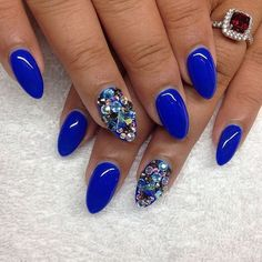 Blue Almond Shaped Nails with Gems Accents.