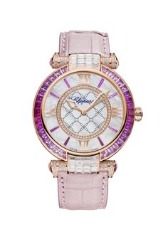 Chopard Imperiale 40 mm Watch | This IMPERIALE timepiece in 18-karat rose gold is a sparkling feast of color. A bezel of pink sapphires and glowing diamonds encircle an elegant mother-of-pearl dial, on which rose sapphire indexes and stately rose-gold hands and Roman numerals take center stage. A regal rose leather strap adds the finishing touch to this utterly unique timepiece.
