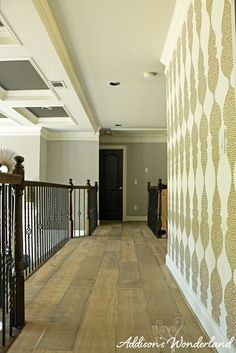 The evolution of our upstairs hallway from fresh gray walls, white oak hardwood flooring and gold ogee wallpaper. Hallway Wallpaper, Decorating On A Budget, Foyer, Floors, Wonderland, Stairs, House Styles, Places, Diy