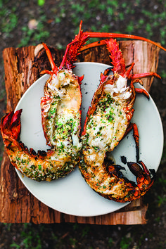 July is National Grilling Month: Try a Grilled Lobster with Garlic-Parsley Butter, perfect summer BBQ dish.