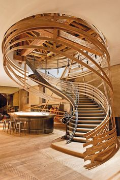Strips of oak wind downwards in this amazing spiral staircase design at Las Heras hotel in Strasbourg, which sits inside the city's former royal stud farm
