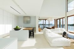 White kitchen and white living space beautifully contrasted against dark trim, and of course the sea views - Gallery of Casa Bahia / Alejandro Landes - 6
