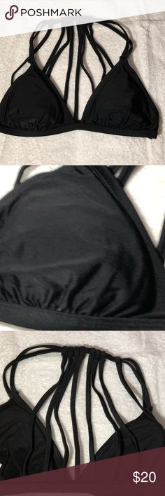 "NWOT-Xhilaration BLACK Bikini top Medium NWOT-Xhilaration Black Bikini Top in size medium.  The back has eight straps that go across which would make you LOOK absolutely gorgeous. This is a very sexy top.  Pair it up with any botyom as it is ""Very flattering"" on the body, if you have any additional questions please refer to the photographs and or message me.  Make a SPLASH and make this an addition to your wardrobe today! Bundle up! Offers always welcome. Xhilaration Swim Bikinis"