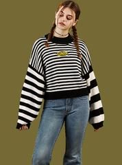 Start everyone's engines in the Derby Top. Cropped baby tee with checkered applique along the shoulder and sleeves. Printed UNIF graphic on the chest. Comes in