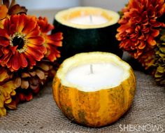 Carve out a gourd, fill with scented candle wax and a wick -- awesome fall candle, from She Knows.