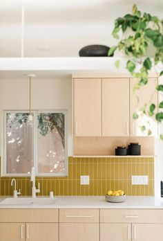 Mid century modern kitchen tile gets a colorful revival in this duplex remodel. Featuring Fireclay favorites Mustard and Hunter Green. Modern Kitchen Tiles, Mid Century Modern Kitchen, Kitchen Colors, Kitchen Design, Home Interior, Kitchen Interior, Kitchen Reno, Kitchen Remodel, Condo Kitchen