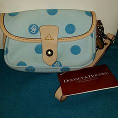ReducedDooney & Bourke clutch Authentic Dooney & Bourke clutch/wallet light blue color with blue DB circles. Never been used NWT has leather wrist strap. *trade value is $45 Dooney & Bourke Bags Clutches & Wristlets