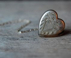 When I was born an old gentleman friend of my parents gave me a heart locket and bracelet set. It was just like this... it belonged to his late wife. I still have it. Wow, such a long forgotten treasure.