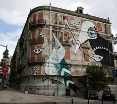 (Crono pairs street artists with abandoned buildings in Lisbon.)