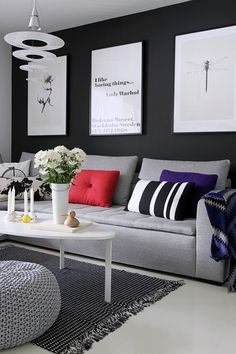 like the grey couch with black walls, large white simple pictures , white table to bring out the pics...
