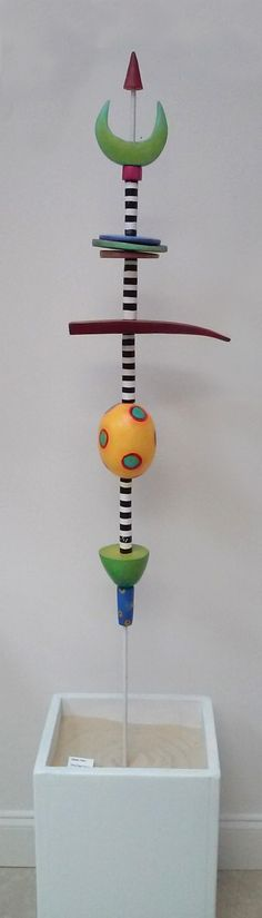 Garden Totem (like the idea of painted pole while adding pieces to the totem) www.ginnypiechstreet.com