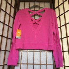 NWT Pink Lucy Feel the Beat Pullover Adorable pink active top with double cross open back. Size medium by Lucy Lucy Tops Sweatshirts & Hoodies