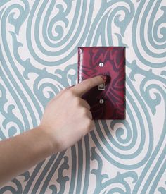 DIY wallpapered switch plates