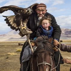 A Kazakh eagle hunter with grandson and his mother in the Altai Mountains, Mongolia. Photo by Tariq Zaidi MT : pics Altai Mountains, Photo Awards, Jolie Photo, Central Asia, World Cultures, People Around The World, Around The Worlds, Beautiful World, Eagles