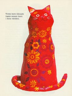 red paper mache cat w/ yellow flowers | P-E Fronning | flickr