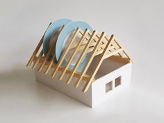 Plate-holder in the shape of a house roof.  Cute gift for an architect or builder.
