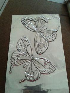 Mariposas en repujado artístico. ..Galy Rodriquez