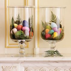 Many of us will have a surplus of decorated Easter eggs soon. To bring some festive cheer in the house, do away with the basket and dig out the glass hurricanes. We saw this lovely idea at Williams Sonoma. We like the look of the palm fronds but all eggs would look nice as well. A large vase would look great too.