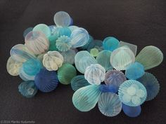Japanese artistMariko Kusumotouses translucent fabric to produce balloon-like objects, orbs that contain various forms trapped within their soft exterior. The creations inside range from smaller versions of the spherical sculptures to sea creatures and cars, playful forms that fit the bright color