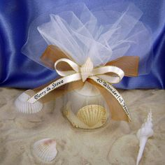This favor caught my eye. I got married in the fall and my wedding will be on the beach, so this favor, everything from the color of the mesh to the ribbon and the shells is beautiful. The example of the favor says for anniversary but it'd be perfect for weddings too!