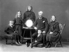 A gentleman and his five children in mourning dress. 1890's