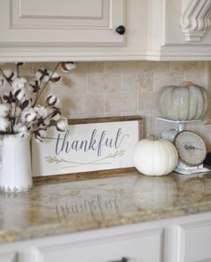 "This week the ladies hosting #OurGratefulHome want to see our #fallkitchen decor. I received this precious ""Thankful"" sign in the mail yesterday from @Charlene Brown.and.ella, so I had to use it right away. It ended up on my kitchen counter with my vintage scale, a couple of pumpkins, and my cotton stems from @Painted Fox, and I love it! Yay for happy mail!"