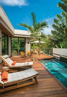 A private outdoor space on the second floor of this home features an Ipe wood deck and a plunge pool. The family enjoys relaxing on cushioned chaise lounges designed by Roque Frizzo, or in a corner on a sofa shaded by a large Shadescapes umbrella.