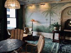 The Esplanade Hotel in St Kilda, Melbourne. #stkilda #espy #visitmelbourne #bottlegreen #greeninterior #distressedmural #relaxeddining #botanicalmural #botanicalinterior #juassicdecor #indoormural #interiormural #botanicaldecor #riparian #primordialchic #wildinterior #naturalmural #rusticcontemporary #muraldetail #palmtreemural #beachscenery #beachinterior #emerald #layeredrugs #persianrugs #greenrug #transitionalrug #retrogreen #greenpalette Botanical Interior, Botanical Decor, Beach Scenery, Green Palette, Painted Walls, St Kilda, Rustic Contemporary, Transitional Rugs, Interior Photography