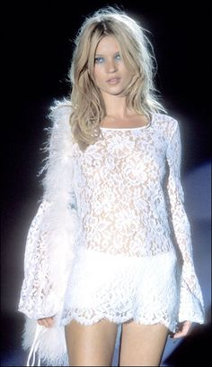 Kate Moss in long sleeved lace mini dress