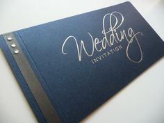 Navy and silver foiled script cheque book wedding invitations with charcoal ribbon and diamantes