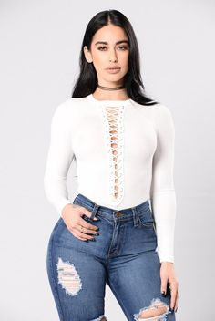 - Available in Ivory and Lavender - Ribbed Bodysuit - Long Sleeve - Criss Cross Chest - V Neckline - Cheeky Bottom - Snap Button Bottom - Made in USA - 48% Rayon 48% Polyester 4% Spandex