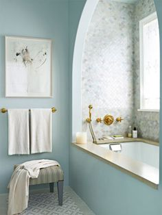Choose One Color, But Use Many Hues    Creating an idyllic bath for a Long Island home, designer DD Allen choose a blue palette but did not limit herself to one shade. The custom watery blue of the polished Venetian plaster walls picks up the blue in the floor tiles. Waterworks Classic Undermount tub. Venetian Plaster by JJ Snyder Studio. Architecture by Michael Pierce.