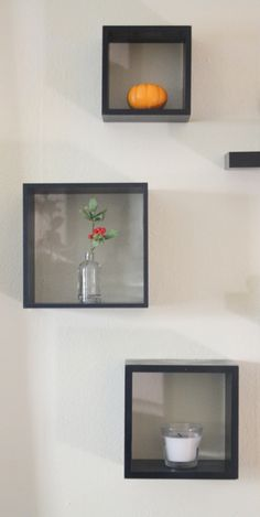 Easy apartment decorating with thrifted wall-mounted cube shelves
