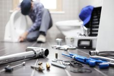 plumber at work in a bathroom, plumbing repair service, assemble and install concept Royalty Free image photo