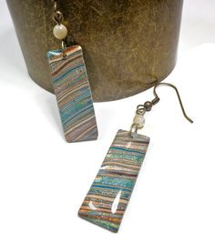 Handmade Earth Tones Sand & Sea Long Dangle Earrings Polymer clay & resin with Shell round beads  This Earring Set is handmade & designed by me, in my sunny Florida studio. They are lightweight & easy to wear,made on antique brass ear wires. I just know you will be thrilled with unique earrings! Size: approx.1 5/8 long rectangle x 3/8 wide dangle length from ear (about 2 1/2)  The matching necklace is available in this listing…