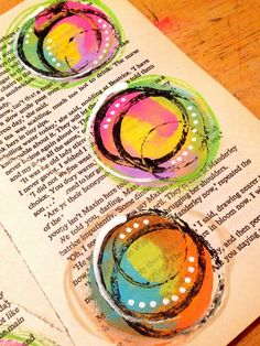 Acrylic paint on book pages