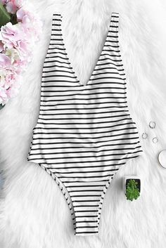 dd343c70013 Live life on the beach. The hottest sale of the season. Cupshe Happiness is  Truth Plunging One-piece Swimsuit can hit the hot season with classic  stripe ...