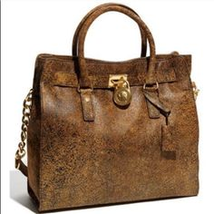 Michael Kors Ostrich leather camel tone bag. Great condition. Gold strap details and key included. Dust bag included. Ask for additional picture ONLY if interested in purchasing . Michael Kors Bags Shoulder Bags