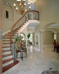 Stunning staircase created using stone, metal and wood components.